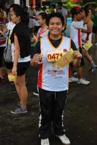 An ACES student with a big smile after finishing the 3k run