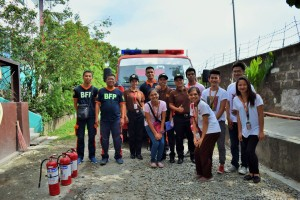 Members of BFP Lucena with ACES students.